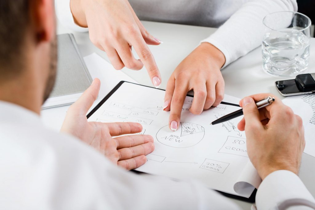 Man and woman discussing a design